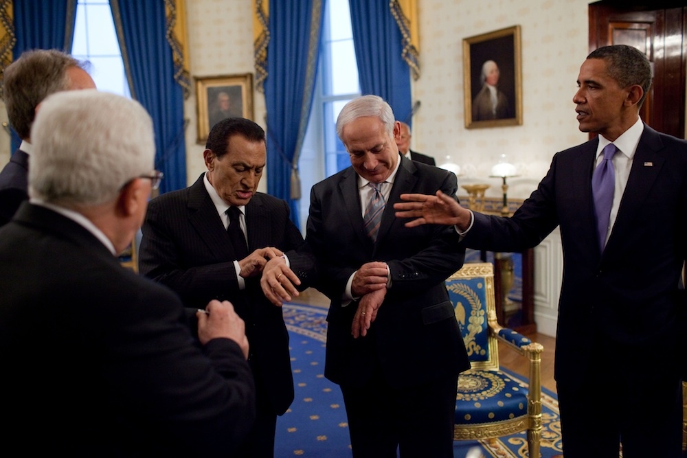 Click photo to download. Caption: President Barack Obama (far right) with Israeli Prime Minister Benjamin Netanyahu and then Egyptian President Hosni Mubarak—both checking their watches—in September 2010 at the White House. Credit: White House.