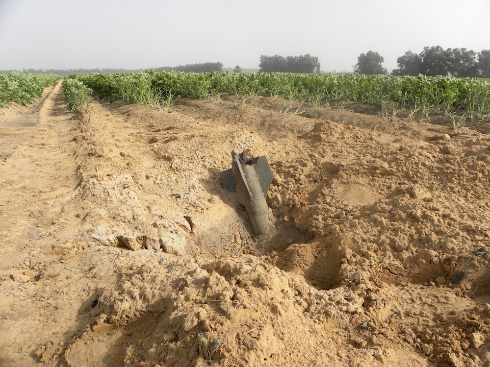 Click photo to download. Caption: A Gaza rocket that fell in an Eshkol Regional Council field in Israel during the ongoing conflict. Credit: Ronit Minaker.