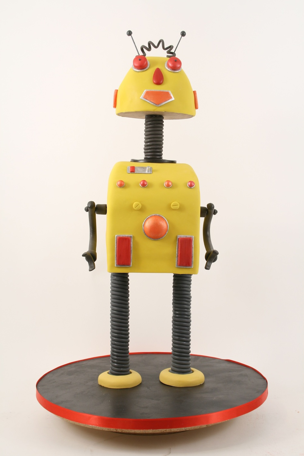 Click photo to download. Caption: A cake designed like a robot from Duff Goldman's Charm City Cakes. Credit: Charm City Cakes.