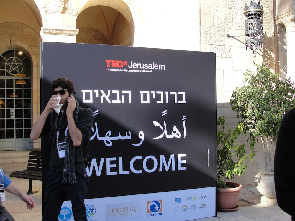 Click photo to download. Caption: The welcome sign for the TEDx Jerusalem conference—in Hebrew, Arabic, and English. Credit: Judy Lash Balint.