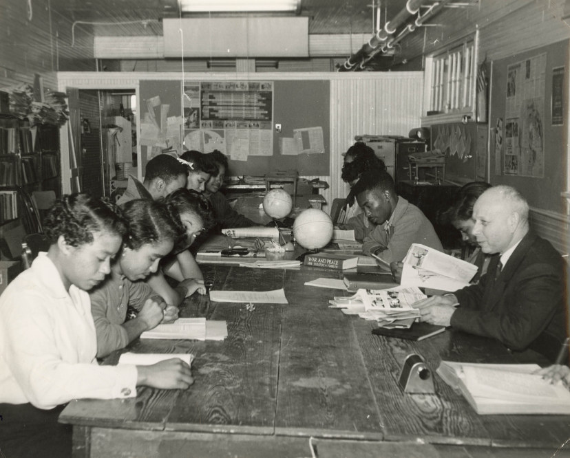Click photo to download. Caption: Professor Ernst Borinski teaching in the Social Science Lab, Tougaloo College, MS, ca. 1960. Prof. Borinski, a refugee from Germany, was part of the Tougaloo community for 36 years. In the Social Science Lab, students were encouraged to think critically and question social attitudes, prejudices, and race relations. Credit: Courtesy of Mississippi Department of Archives and History.