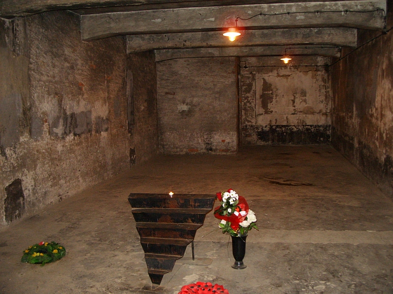 Click photo to download. Caption: Auschwitz gas chamber memorial. Two women were fired for mocking the killing of Jews in gas chambers and crematoriums. Credit: Wikimedia Commons.