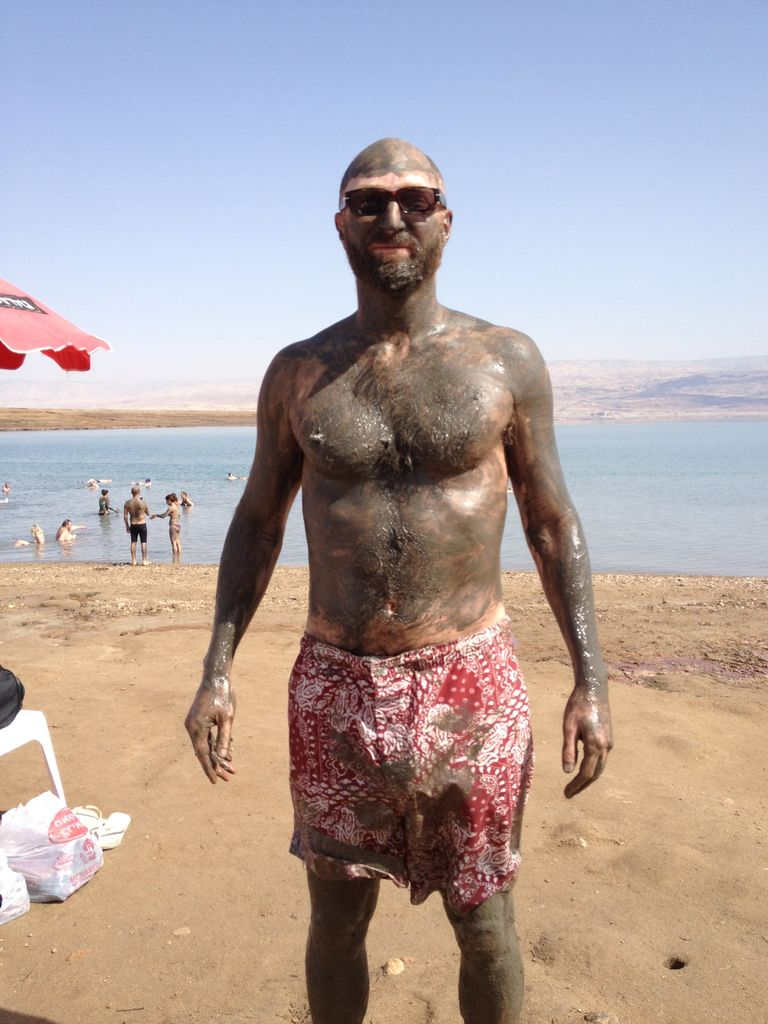 "Click photo to download. Caption: Jonathan Ames, creator of the HBO television series ""Bored to Death,"" takes a mud bath at the Dead Sea in Israel. Credit: Courtesy Jonathan Ames."