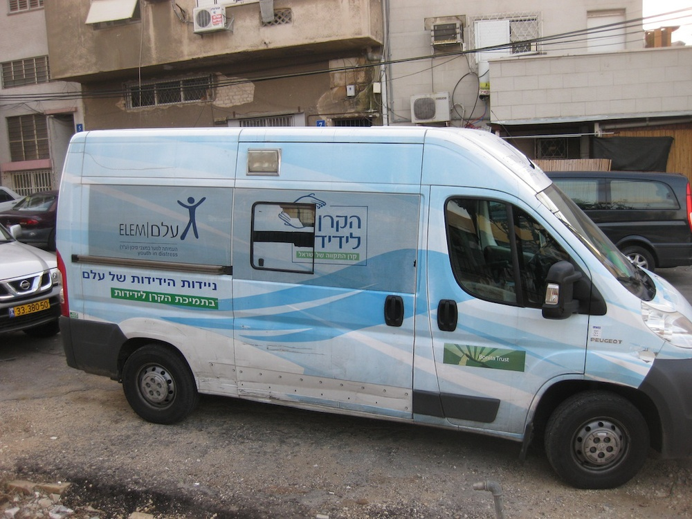 "Click photo to download. Caption: A van of ELEM, which aids at-risk youths in Israel. Nava Barak, ex-wife of Ehud Barak, is at the forefront of ELEM's efforts. Credit: Mitchell Slepian.                 0     0     1     5     28     JNS     1     1     32     14.0                            Normal     0                     false     false     false         EN-US     JA     X-NONE                                                                                                                                                                                                                                                                                                                                                                                                                                                                                                                                                                                                                                                                                                                            /* Style Definitions */ table.MsoNormalTable 	{mso-style-name:""Table Normal""; 	mso-tstyle-rowband-size:0; 	mso-tstyle-colband-size:0; 	mso-style-noshow:yes; 	mso-style-priority:99; 	mso-style-parent:""""; 	mso-padding-alt:0in 5.4pt 0in 5.4pt; 	mso-para-margin:0in; 	mso-para-margin-bottom:.0001pt; 	mso-pagination:widow-orphan; 	font-size:12.0pt; 	font-family:Cambria; 	mso-ascii-font-family:Cambria; 	mso-ascii-theme-font:minor-latin; 	mso-hansi-font-family:Cambria; 	mso-hansi-theme-font:minor-latin;}"