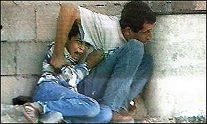 Jamal and   Muhammad al-Dura take cover in the Gaza Strip in 2000. The IDF is not responsible for the 2000 al-Dura shooting, a new Israeli government report found. Credit: France 2.