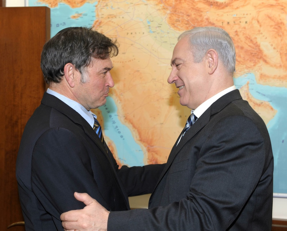 Click photo to download. Caption: On Feb. 19, 2012, Prime Minister Benjamin Netanyahu congratulates Dr. Yehuda David upon his acquittal in France's highest court after he had been sued for libel by Jamal al-Dura for refuting claims that Jamal was injured in a 2000 shooting in the Gaza Strip. Israel was further vindicated in relation to the incident Sunday when a government report said the IDF was not responsible for the death of Jamal's son, Muhammad. Credit: Moshe Milner/GPO/Flash90.