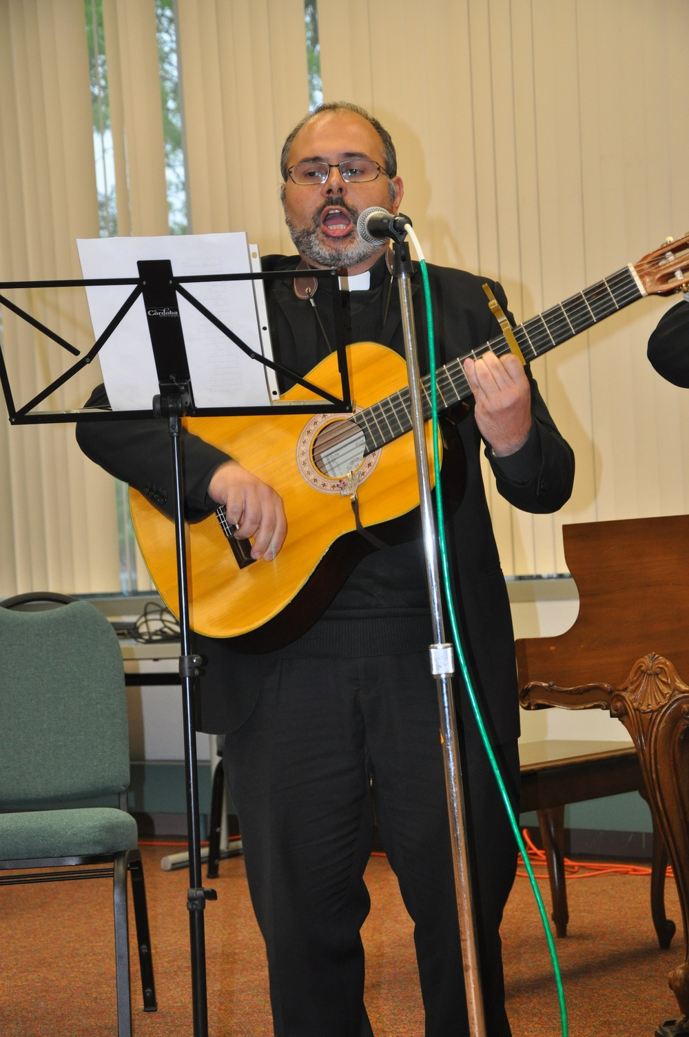 Click photo to download. Caption: Father Marco Pacciana of Our Lady of Good Counsel in Newark sings the Shema prayer at the first Holocaust seder in Whippany, NJ, on May 19. Credit: Michele Alperin.