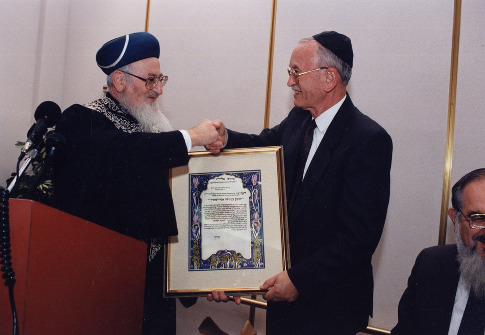 Click photo to download. Caption: Stanley Abramovitch (left) receives rabbinical ordination from Chief Rabbi Mordechai Eliyahu in Israel, November 1995. Credit: JDC.
