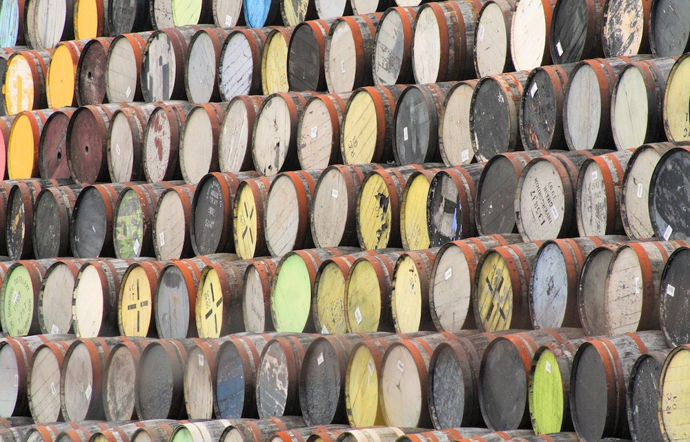 Click photo to download. Caption: Whisky barrels at the White and MacKay distillery in Invergordon, Scotland. Credit: John Haslam.
