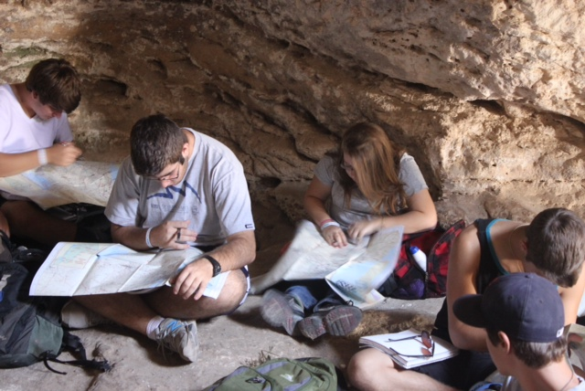 Click photo to download. Caption: Participants of the Alexander Muss High School in Israel (AMHSI) program study in a cave near the Madras Ruins just south of Jerusalem. Credit: Lisë Stern.