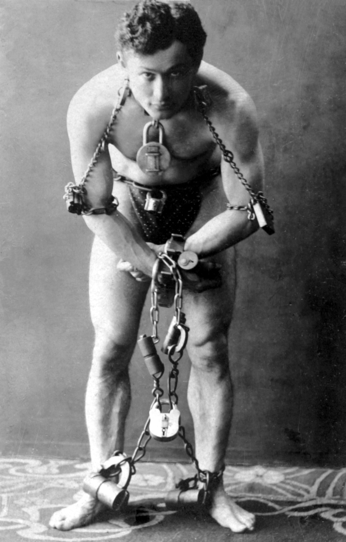 Click photo to download. Caption: Ehrich Weisz was born in 1874 in Hungary, but joined a traveling circus at the age of 9. He would grow up to become the world-famous magician Harry Houdini (pictured). Credit: Library of Congress. Ehrich Weisz
