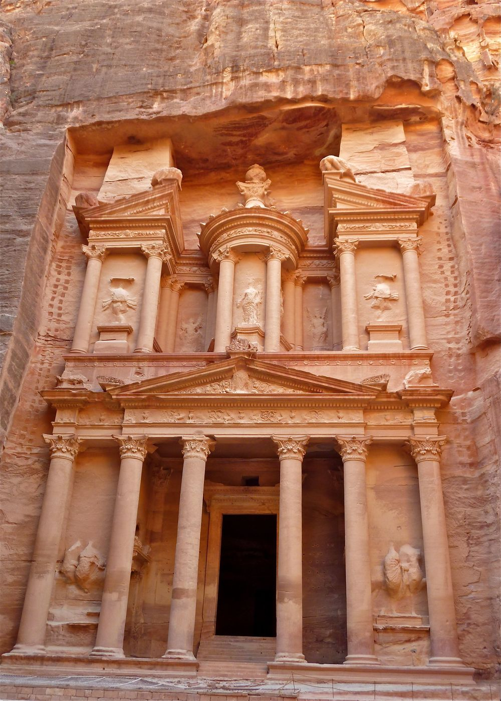 "Click photo to download. Caption: Carved into a cliff face in the early 1st century, and featured heavily in Indiana Jones, the ""Treasury"" is one of Petra's main attractions. Credit: Masada Siegel."