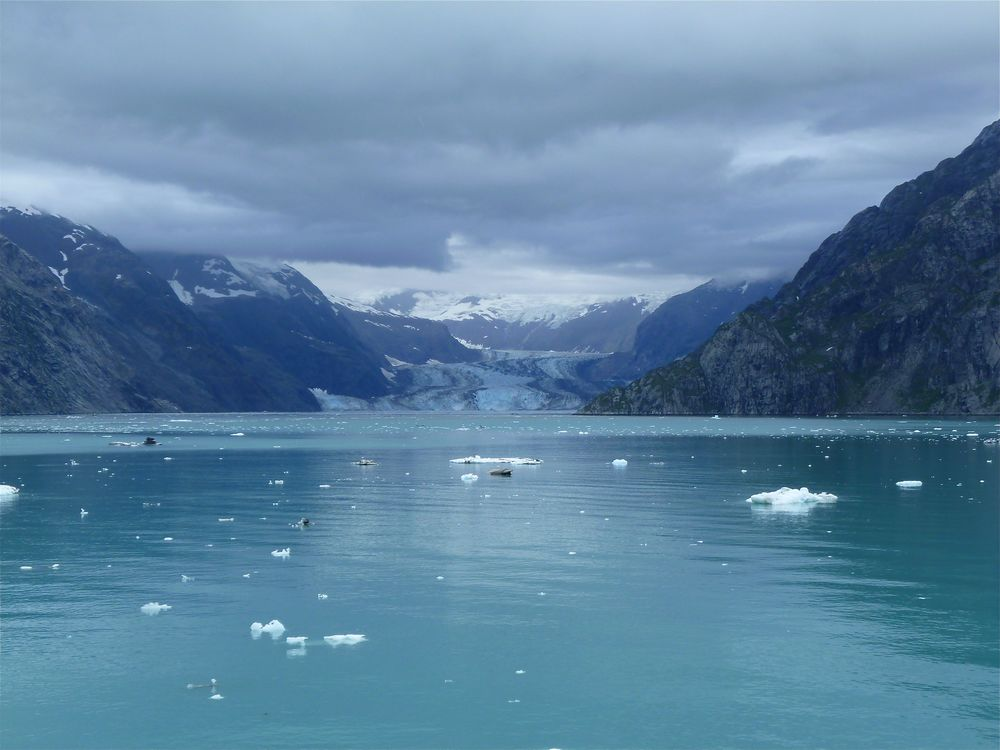Click photo to download. Caption: The view of an Alaskan lake and glacier from a cruise ship. Credit: Masada Siegel.
