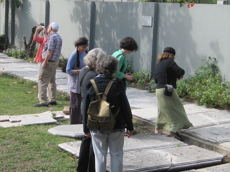 Click photo to download. Caption: Attendees of a 2010 conference explore Shaa're Shalom Synagogue's courtyard and cemetery in Kingston, Jamaica. Credit: Paul Foer.