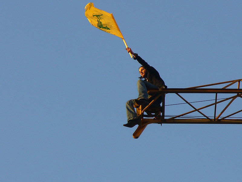 Click photo to download. Caption: The flag of Hezbollah waving after the 2006 war with Israel. Credit: Wikimedia Commons.