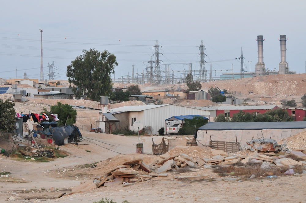 Click photo to download. Caption: A Bedouin encampment near the Ramat Hovav industrial zone in the Negev. The proposed Prawer Law, which would retroactively legalize tens of thousands of Bedouin structures, has angered anti-settlements NGOs because it stipulates that several thousand Bedouin must relocate from positions in close proximity to  Ramat Hovav, a site that has been deemed unsuitable for residential zoning due to the pollutants emitted from the factories. Credit: Shay Levy/Flash90.