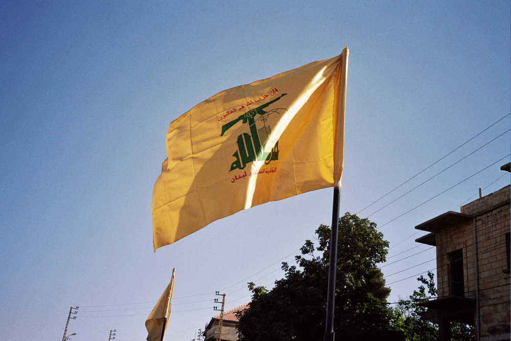 Click photo to download. Caption: The flag of Hezbollah flies in Syria, where Hezbollah has become an active element in a civil war that has claimed the lives of 80,000 people. Credit: Hezbollah Flag/Wikimedia Commons.