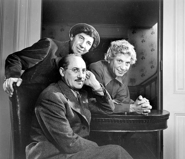 Click photo to download. Caption: The Marx Brothers, from left to right: Chico, Harpo, and Groucho (sitting). Credit: Yousuf Karsh via Wikimedia Commons.