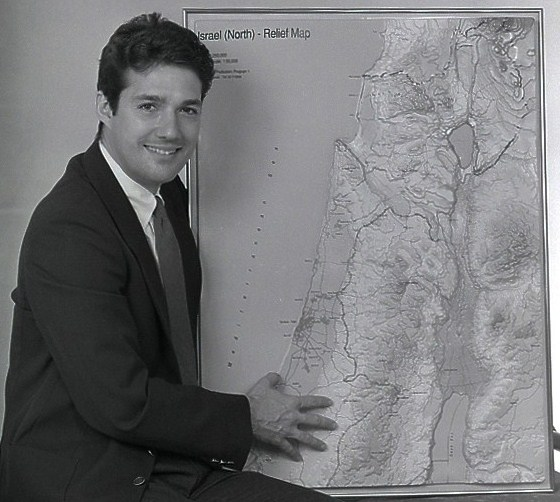 Click photo to download. Caption: Mark Langfan with one of his Middle East maps. Credit: Courtesy Mark Langfan.