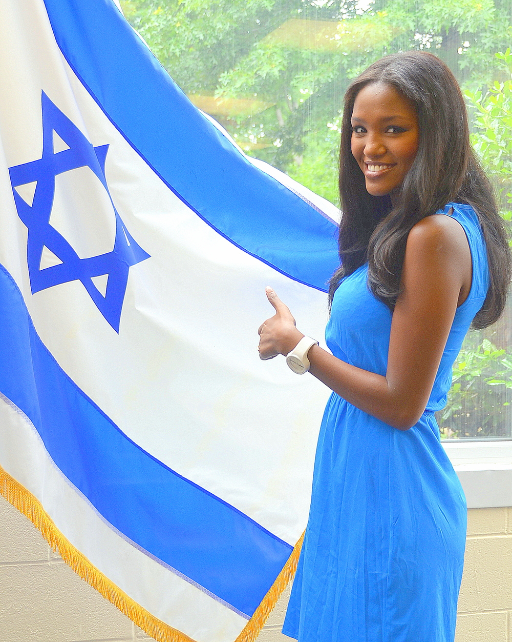 Click photo to download. Caption: Yitayish Ayenew, the first black Miss Israel and also the first woman of Ethiopian heritage to win the crown, poses with the Israeli flag at Solomon Schechter Day School of Bergan County, NJ, on June 14. Credit: Maxine Dovere.