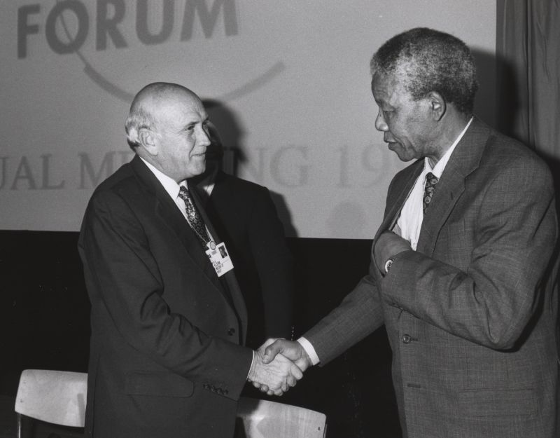 Frederik de Klerk and Nelson Mandela shake hands at the Annual Meeting of the World Economic Forum in Davos, Switzerland, in January 1992. Credit: World Economic Forum.