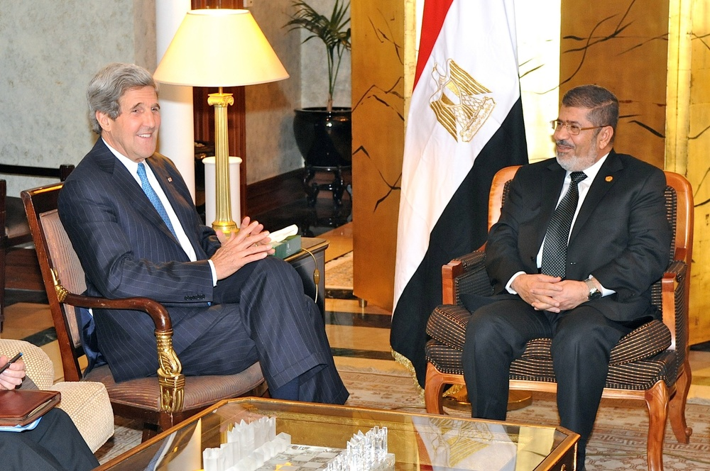 U.S. Secretary of State John Kerry meets with Egyptian President Mohamed Morsi as the two attend the 50th anniversary African Union Summit in Addis Ababa, Ethiopia, on May 25, 2013. Egyptian protesters from the country's Christian and secular minorities have accused the U.S. administration of supporting Morsi's Islamist government at their expense. Credit: State Department.
