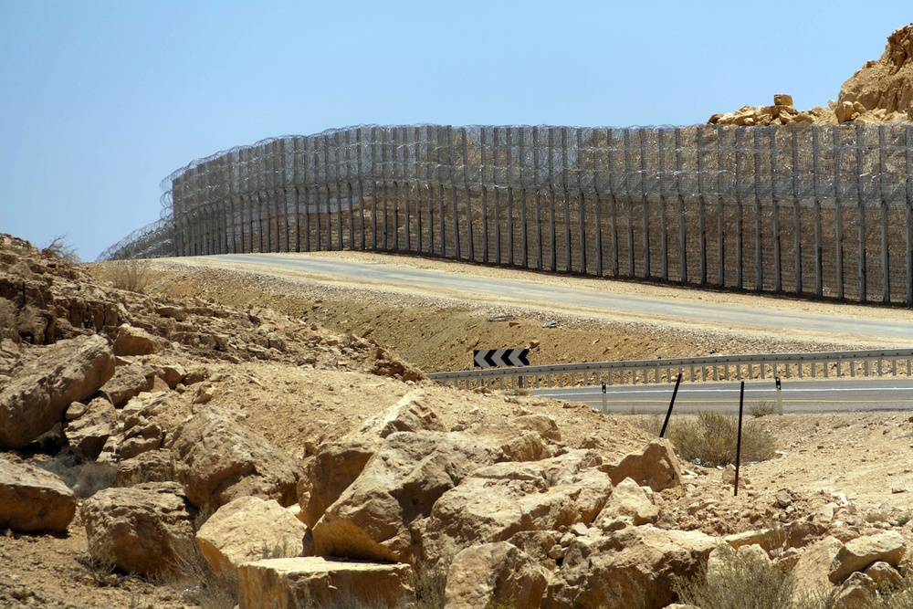 The fence along the Israel-Egypt border built in 2012. Illegal infiltration is significantly down in Israel. Credit: Wikimedia Commons.
