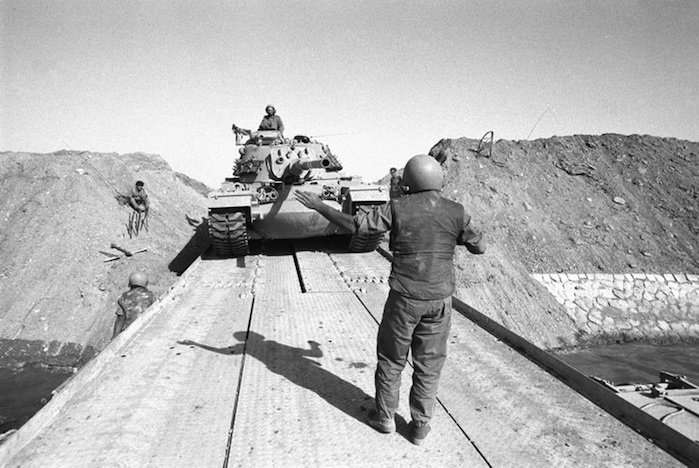 Click photo to download. Caption: Israeli tanks which crossed into the Suez Canal's western border and reached within 101 kilometers of Cairo during the Yom Kippur War. Using innovative tactics and advanced technology, Israeli forces achieved a remarkable military recovery, breaking the Arab advance and encircling Egyptian forces in the Sinai. Credit: IDF photo archives.
