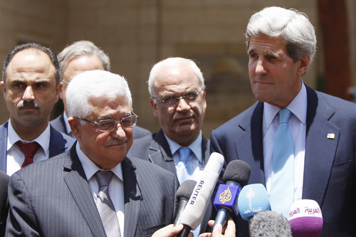 Click photo to download. Caption: U.S. Secretary of State John Kerry and Palestinian Authority President Mahmoud Abbas at a press conference following their meeting in Ramallah on June 30, 2013. Credit: Issam Rimawi/Flash90.
