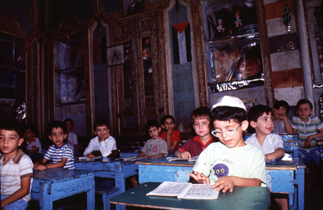 Pupils in the Jewish Maimonides school taken on February 9, 1991 in Damascus, Syria. The photo was taken shortly before the exodus of most of the remaining Syrian Jewish community in 1992. Credit: Diaspora Museum Visual Documentation Archive, Tel Aviv.