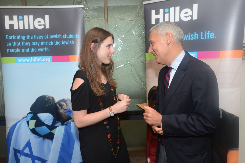 Click photo to download. Caption: Eric Fingerhut, Hillel's next president and CEO, speaks with student board member JoHanna Rothseid. Credit: Shahar Azran for Hillel.