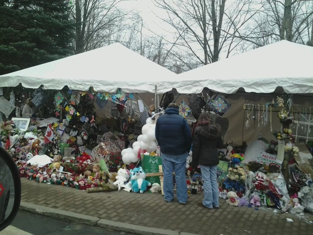"Click photo to download. Caption: The Sandy Hook Elementary School shooting makeshift memorial on Berkshire Road in Newtown, Conn., 12 days after the December 2012 shooting. The shooting inspired Frank Storch's to create the new school safety tips guide, ""Keep Your School Safe,"" a project he says he undertook ""purely for the love of the Jewish people."" Credit: Bbjeter via Wikimedia Commons."