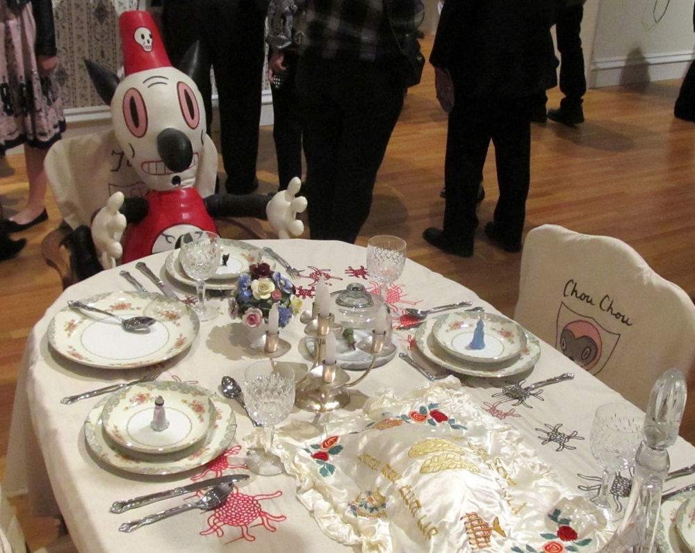 Click photo to download. Caption: Toby, one of the characters of contemporary artist Gary Baseman, is seated at the Jewish holiday table in Baseman's show at the Skirball Cultural Center in Los Angeles. Credit: Edmon J. Rodman.