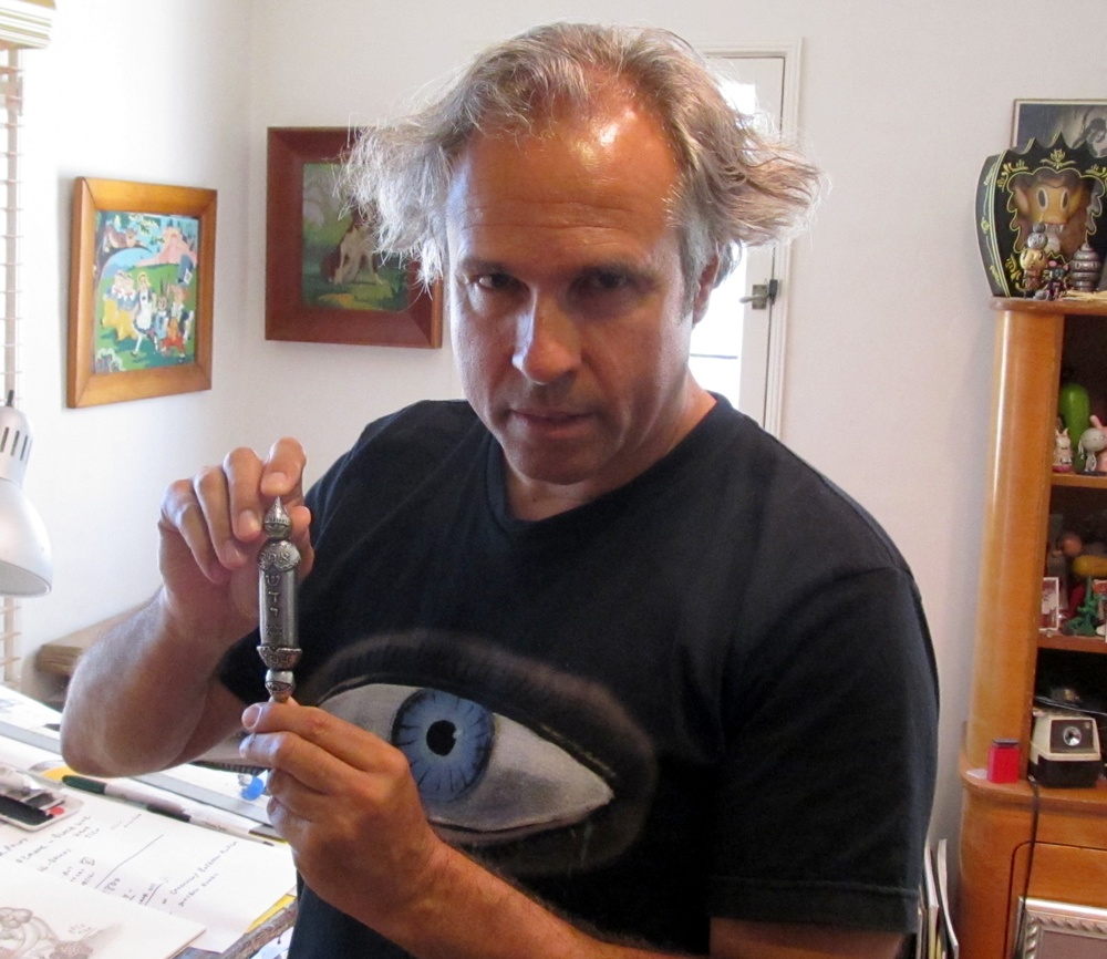 Click photo to download. Caption: Contemporary artist Gary Baseman with the mezuzah he designed, based on the one from his parents' home, for his show at the Skirball Cultural Center in Los Angeles. Credit: Edmon J. Rodman.