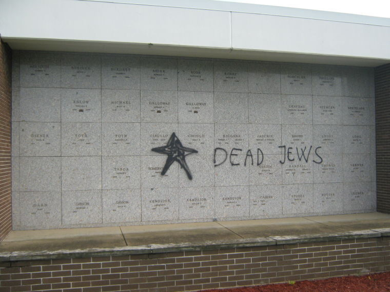 An Akron man was arrested Aug. 2 and charged with vandalism for anti-Semitic comments spray painted on a mausoleum at Hillside Memorial Park in Springfield Township, Ohio. Credit: Springfield Township Police Department.