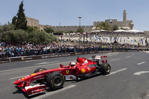Click photo to download. Caption: Formula One Scuderia Ferrari team driver<br /> Giancarlo Fisichella drives a Ferrari F60 past The Tower of David and the<br /> ancient walls of Jerusalem's Old City, during the second day of the<br /> Jerusalem Formula Peace Road Show, on June 14, 2013. The first-ever two-day<br /> Jerusalem Formula Peace Road Show includes Formula One racing teams,<br /> Scuderia Ferrari and Marussia, Ferrari Challenge cars, drifting cars and<br /> Grand Prix motorcycles all participating in the show, whose circuit passes<br /> landmarks such as Jerusalem's Old City walls.
