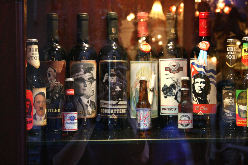 Tourists shopping for Italian wines while on vacation in Italy have been discovering bottles like these with Nazi slogans and images of Adolf Hitler (left). Credit: Wikimedia Commons.
