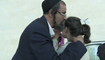 A family of Yemenite Jews reunites in Israel on Wednesday. Credit: Israel Hayom video screenshot.