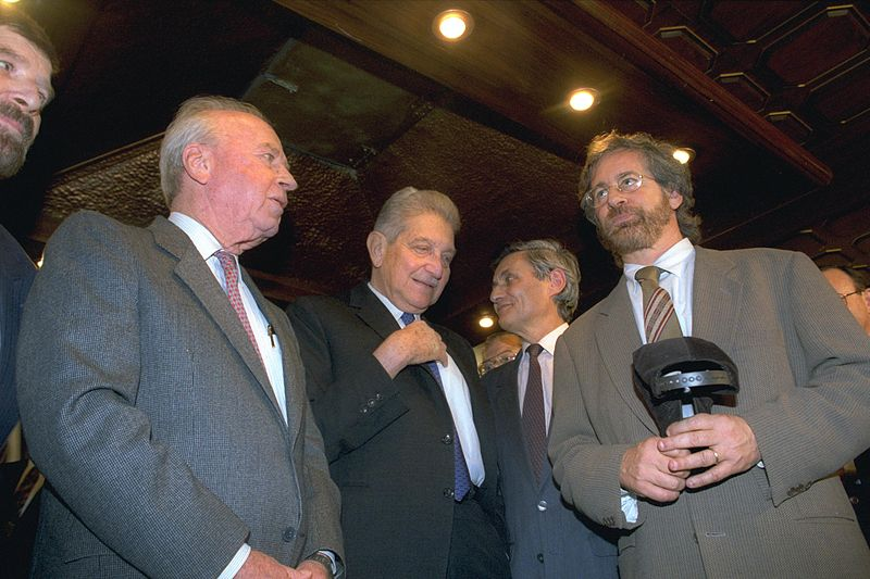 "Former Israeli President Ezer Weizman (center) and Former Israeli Prime Minister Yitzhak Rabin (left) with film director Steven Spielberg (right) at the Israeli premier of his movie ""Schindler's List"" in 1994. Credit: Wikimedia Commons."
