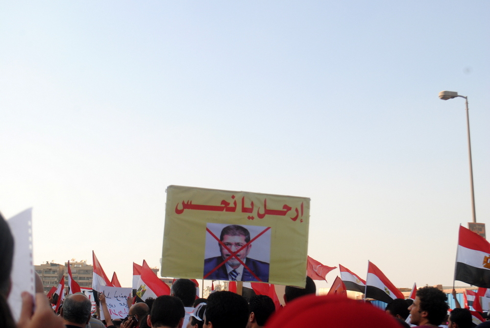 A protest against former Islamist president Mohamed Morsi in Egypt on June 28, 2013. Tamarod, the movement that launched the movement that toppled Morsi, is calling for Egypt's peace treaty with Israel to be reversed. Credit: Lilian Wagdy via Wikimedia Commons.