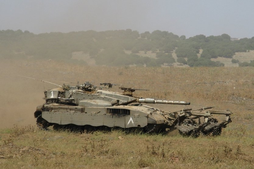 An IDF tank. Future U.S. military aid to Israel is being discussed while the Middle East threats around the Jewish state are growing. Credit: Michael Aronov via Wikimedia Commons.