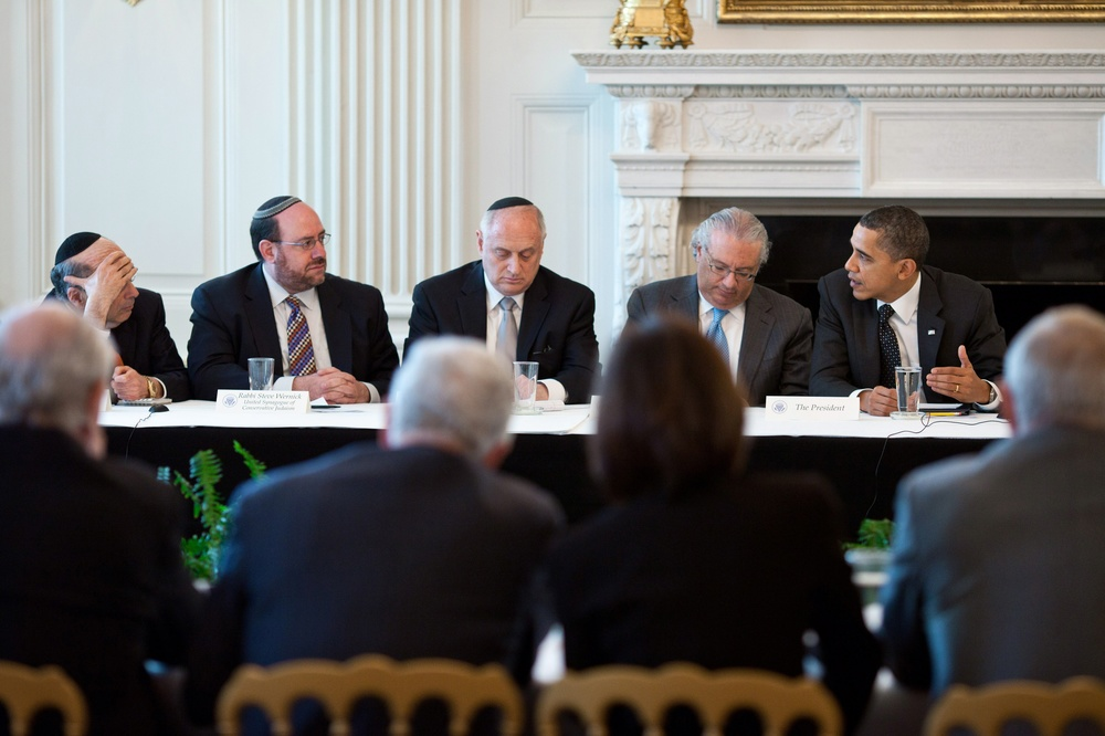 "Click photo to download. Caption: President Barack Obama meets with leaders from the Conference of Presidents of Major American Jewish Organizations in the State Dining Room of the White House on March 1, 2011. Far from being the war-crazed cabal that is depicted in the imaginations of conspiracy theorists, the ""Israel Lobby"" is in reality an oasis of calm reliability for a president who may just be on the cusp of his biggest foreign policy failure, in Syria, writes columnist Ben Cohen. Credit: White House photo by Pete Souza."