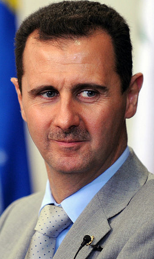 Syrian President Bashar al-Assad (pictured) could avoid a U.S. strike by surrendering Syria chemical weapons, U.S. Secretary of State John Kerry said Monday in comments later backtracked by the State Department. Credit: Wikimedia Commons.