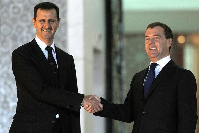 Click photo to download. Caption: Syrian President Bashar al-Assad and Russian Prime Minister Dmitry Medvedev meet in Syria in May 2010. Russia has proposed a plan to secure Syria chemical weapons. Credit: Presidential Press and Information Office.