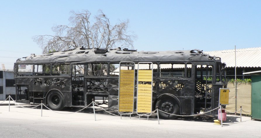 Charred remains of an Israeli bus that was attacked by Palestinian terrorists in 1978. Credit: MathKnight via Wikimedia Commons.