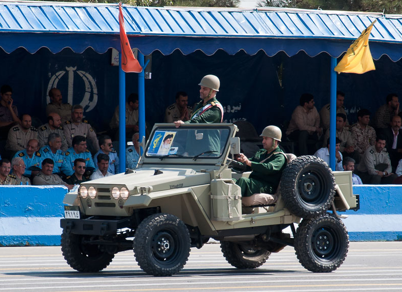 An Islamic Revolutionary Guard Corps vehicle rides in an Iranian street. Credit: M-ATF via Wikimedia Commons.