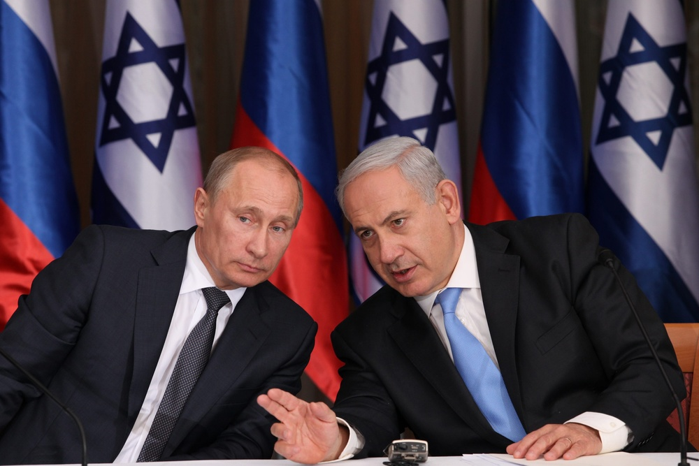 Click photo to download. Caption: Israeli Prime Minister Benjamin Netanyahu (right) holds a joint press conference with Russian President Vladimir Putin at Netanyahu's residence in Jerusalem on June 25, 2012. Russian-Israeli relations have improved significantly since the Cold War, but will Russia's recent meteoric rise in the Middle East—including its brokering of the Syria chemical weapons deal—change that relationship? Credit: Marc Israel Sellem/POOL/FLASH90