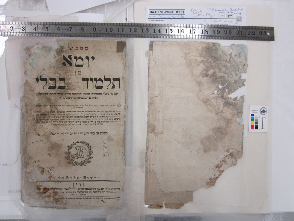 Click photo to download. caption: During treatment by the National Archives and Records Administration, a Babylonian Talmud from Vienna, dating back to 1793. The Talmud is part of what has become known as the Iraqi Jewish Archive. Credit: National Archives and Records Administration.