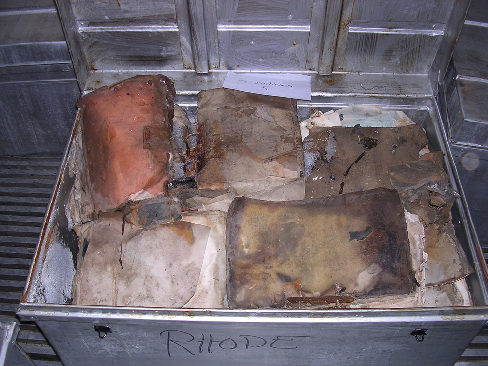 Click photo to download. Caption: Jewish items recovered from the flooded basement of the Mukhabarat, Saddam Hussein's intelligence headquarters, in 2003, before treatment. Credit: National Archives and Records Administration.