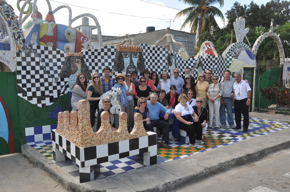Click photo to download. Caption: A tour group visits the colorful home, west of Havana, of famed Cuban artist Jose Fuester, known as the Picasso of the Caribbean. Credit: Marla Whitesman.